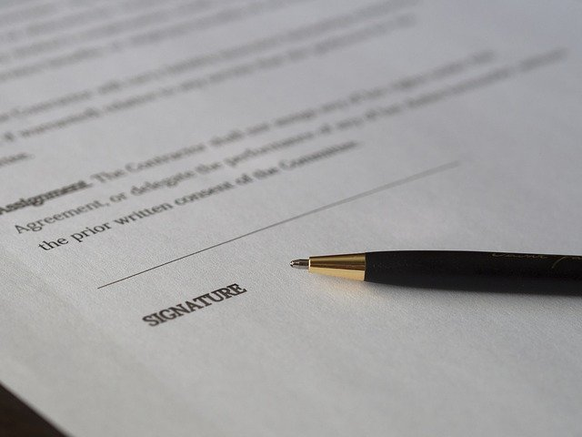 Image of a written agreement on what to check when signing your tenancy agreement