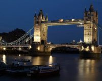 Image of tower bridge at night on article best cities in uk for shopping