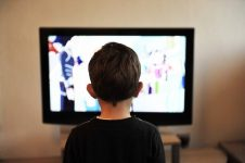Image of a child watching tv on student housing bills