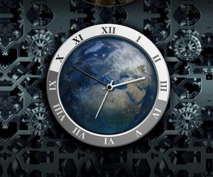 Image of a clock with the world in it on how to find out your uni flatmates