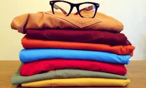Image of a pile of different coloured trousers on what to pack when studying abroad