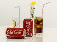 Image of coca cola cans and in glass on how to avoid a hangover