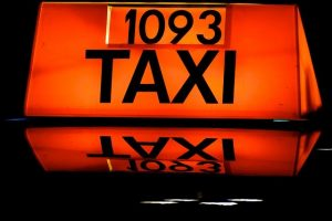 Image of light up taxi sign on how to stay safe on a night out