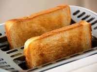 Image of toast in toaster on how to deal with a hangover